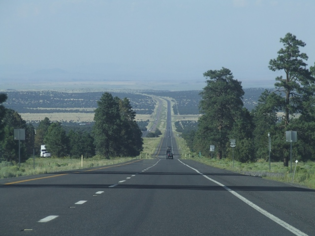 Long, flat highway descends into the distance