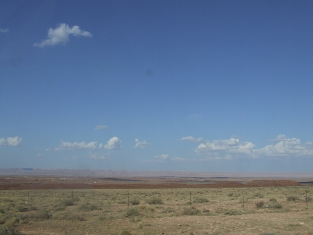 Empty desert with bright blue sky