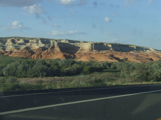White and red cliffs with pasture in the foreground