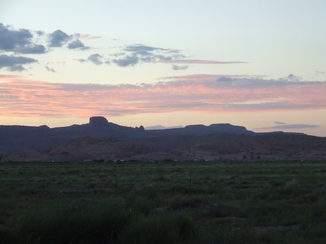 Sunset over silhouetted buttes